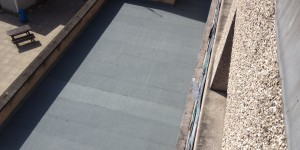 Flat roof up-grade using Torch-on-felt